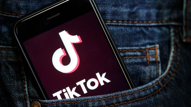 PARIS, FRANCE - MARCH 05: In this photo illustration, the social media application logo, Tik Tok is displayed on the screen of an iPhone on March 05, 2019 in Paris, France. The social network broke the rules for the protection of children's online privacy (COPPA) and was fined $ 5.7 million. The fact TikTok criticized is quite serious in the United States, the platform, which currently has more than 500 million users worldwide, collected data that should not have asked minors. TikTok, also known as Douyin in China, is a media app for creating and sharing short videos. Owned by ByteDance, Tik Tok is a leading  video platform in Asia, United States, and other parts of the world. In 2018, the application gained popularity and became the most downloaded app in the U.S. in October 2018. (Photo by Chesnot/Getty Images)
