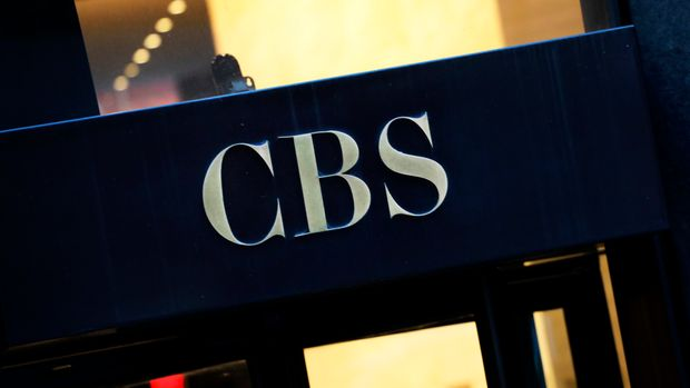 FILE - This Thursday, Dec. 6, 2018, file photo shows the CBS logo at the entrance to its headquarters, in New York. CBS is unveiling its fall 2019 prime-time schedule on Wednesday, May 15, 2019, and will host a presentation to advertisers with some of its top talent describing their newest shows. (AP Photo/Mark Lennihan, File)
