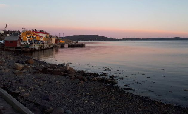 The sun sets on Didlo, NL on May 25,