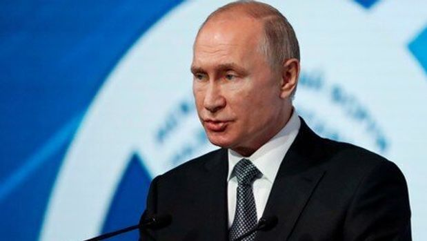 "FILE PHOTO: Russian President Putin attends the International Forum ""Development Of Parliamentarism"" in Moscow"