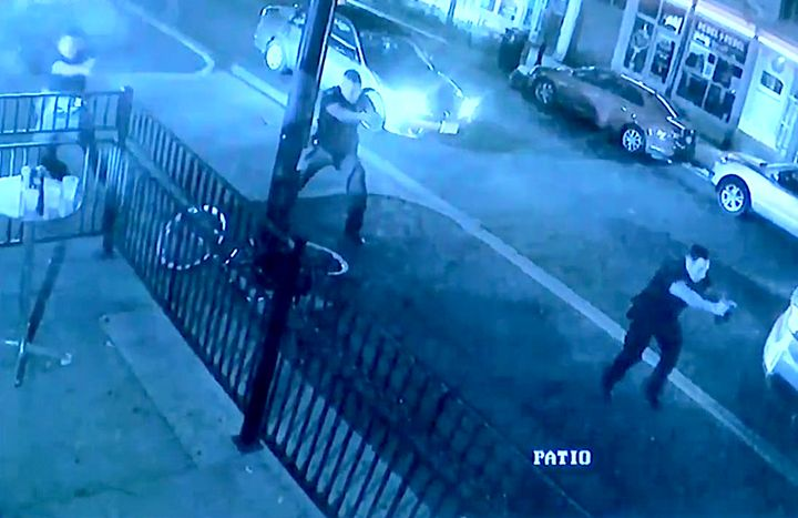 Surveillance footage near Ned Peppers shows police officers responding to the gunman within seconds of his first shot.