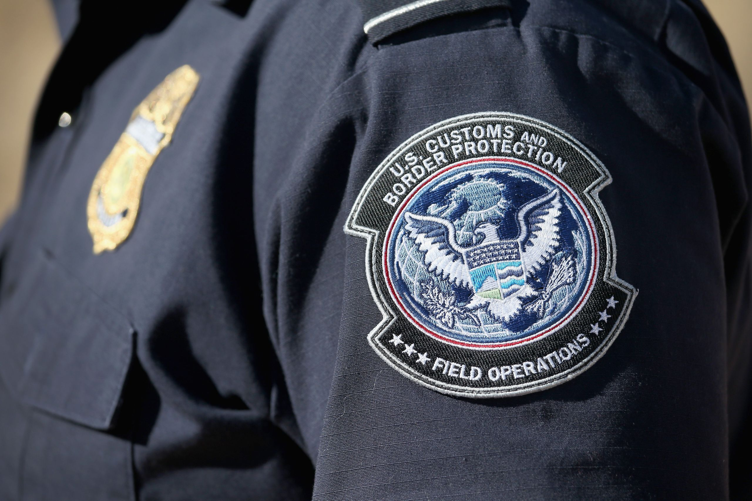 An officer from the U.S. Office of Field Operations stands near the U.S.-Mexico border on Feb. 26, 2013, in Nogales, Arizona.
