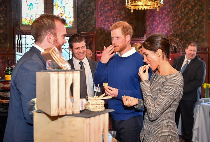 Prince Harry and Meghan Markle taste traditional cakes during a visit to Cardiff Castle.