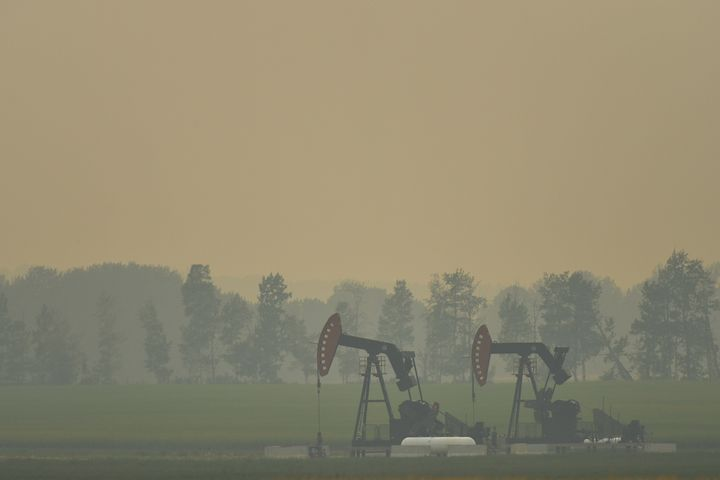 An extraction pump for oil and gas on a field near the town of Sundre during smoky and hazy weather conditions that blanketed the province of Alberta in the summer of 2018, impacted by B.C. wildfire smoke.