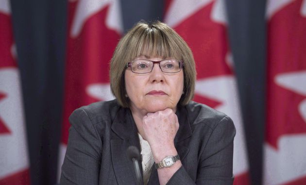 Anne McLellan, leader of the federal task force on marijuana, listens to a question during a news conference...