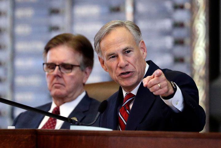 Texas Gov. Greg Abbott, right, sits beside fellow immigration hardliner Lt. Gov. Dan Patrick. Both will join a state task force that aims to ramp up efforts to surveil white nationalists.