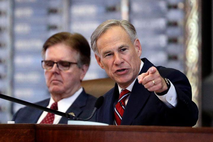 Texas Gov. Greg Abbott, right, sits beside fellow immigration hardliner Lt. Gov. Dan Patrick. Both will join a state task for