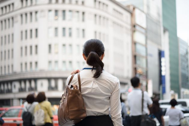 businesswoman's outdoor image in Ginza, a famous commercial district of Tokyo, photographed naturally...