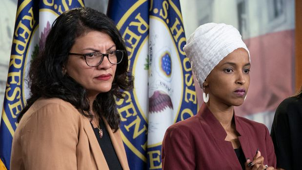"FILE - In this July 15, 2019, file photo, from left, Rep. Rashida Tlaib, D-Mich., Rep. Ilhan Omar, D-Minn., Rep. Alexandria Ocasio-Cortez, D-N.Y., and Rep. Ayanna Pressley, D-Mass., respond to remarks by President Donald Trump after his call for the four Democratic congresswomen to go back to their ""broken"" countries, during a news conference at the Capitol in Washington. A North Carolina gun shop that drew nationwide attention with a billboard targeting the four minority congresswomen replaced it Monday, Aug. 5, with a sign praising the First Amendment. (AP Photo/J. Scott Applewhite, File)"
