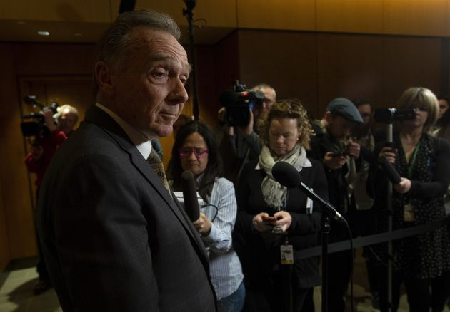 Conservative MP Peter Kent speaks with the media in Ottawa on March 26,