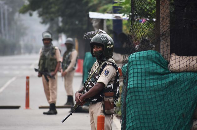 Soldiers patrol the deserted street during the official celebration of India's Independence day in Srinagar,...