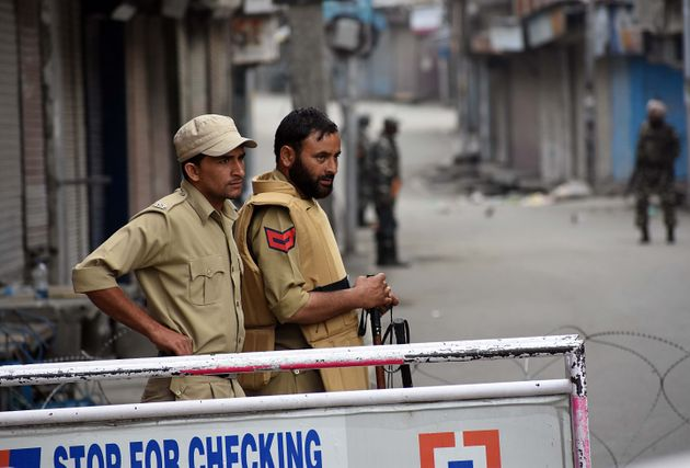 Policemen stand alert during the official celebration of India's Independence day in Srinagar,Kashmir...