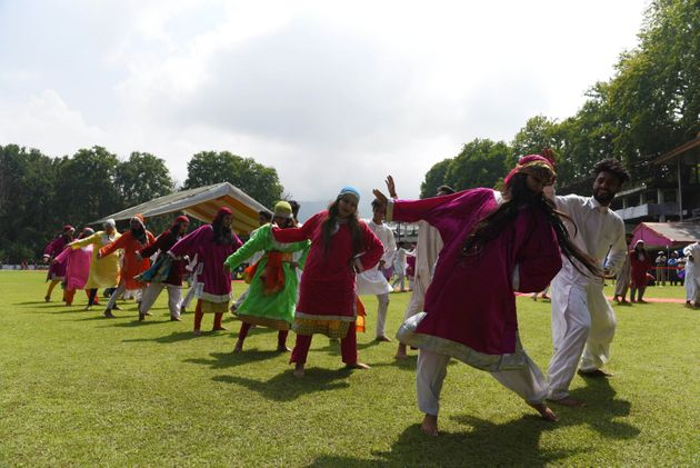 Artists perform during the 73rd Independence Day celebrations at Sher-i-Kashmir Cricket Stadium, on August...
