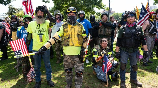 TOM MCCALL WATERFRONT PARK, PORTLAND, OREGON, UNITED STATES - 2018/08/04: Far right protesters march in Tom McCall Waterfront Park as part of the Patriot Prayer Rally. The Proud Boys organized the Patriot Prayer Rally in Portland. The Proud Boys, a far right group supportive of President Donald Trump, used inflammatory language ahead of their rally, with some members promising violence. Counter-protesters led by Antifa confronted the participants of the Patriot Prayer Rally and clashed with police, leading to arrests and injuries. (Photo by Kainoa Little/SOPA Images/LightRocket via Getty Images)