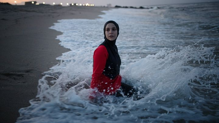 Manar Hussein in the water at a New Jersey beach.