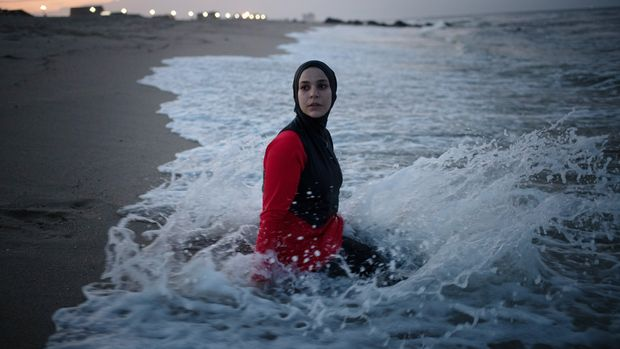 Manar Hussein at a beach in New Jersey June 26, 2019. This was Hussein's first time wearing a burkini in the water. Kholood Eid for Huffington Post