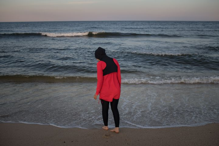 Manar Hussein at a beach in New Jersey, June 26, 2019. This was Hussein's first time wearing a burkini in the water.