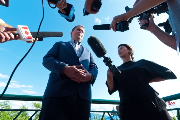 Andrew Scheer takes questions from the media in Dieppe, N.B., on Aug. 15,