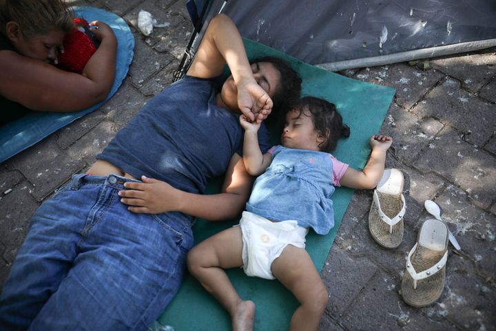Migrants rest near a Mexican immigration center in Matamoros, Mexico. Turning Mexican border cities into waiting rooms for as
