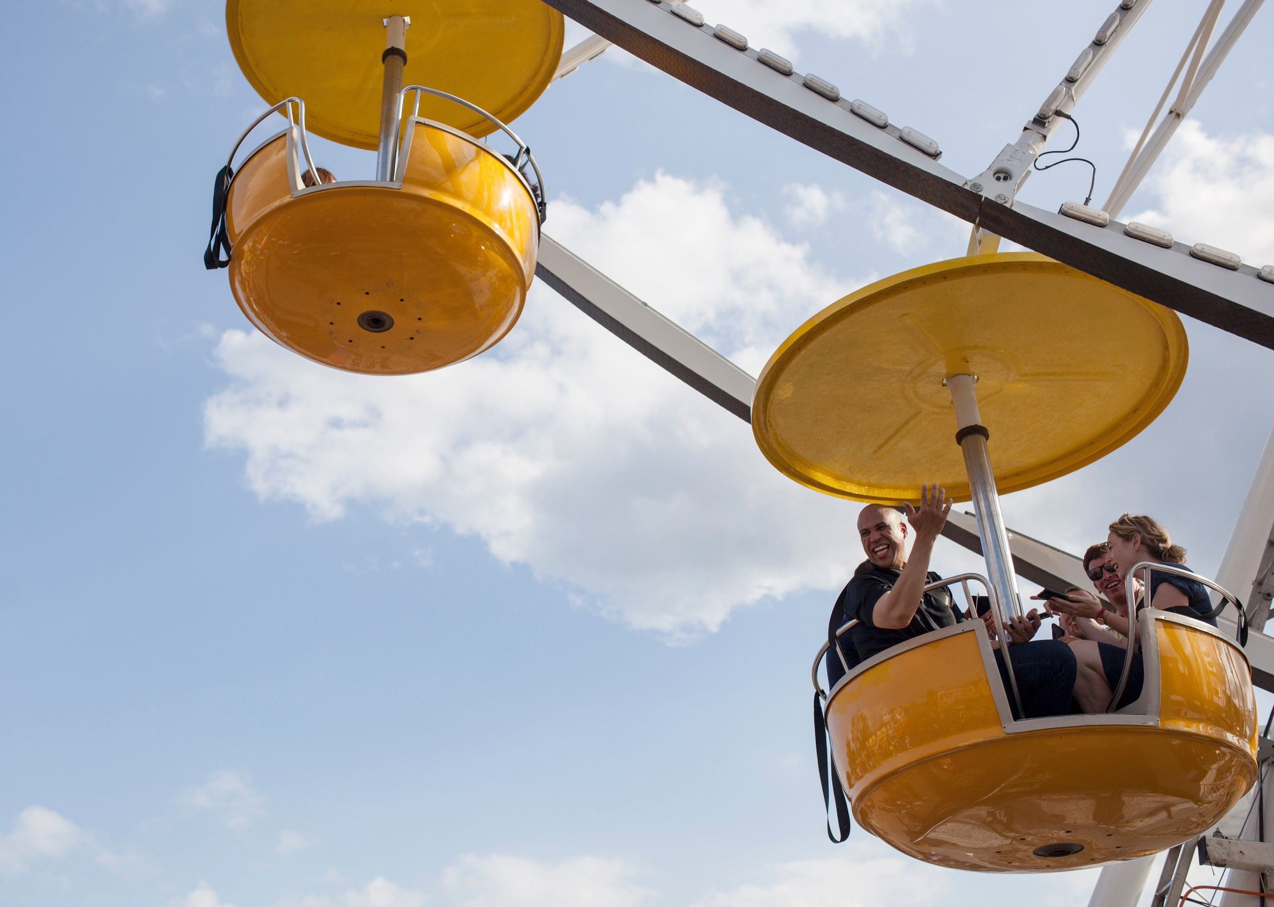 Sen. Cory Booker (D-N.J.) rides the Ferris wheel with reporters on Saturday, Aug. 10, 2019, at the Iowa State Fair.