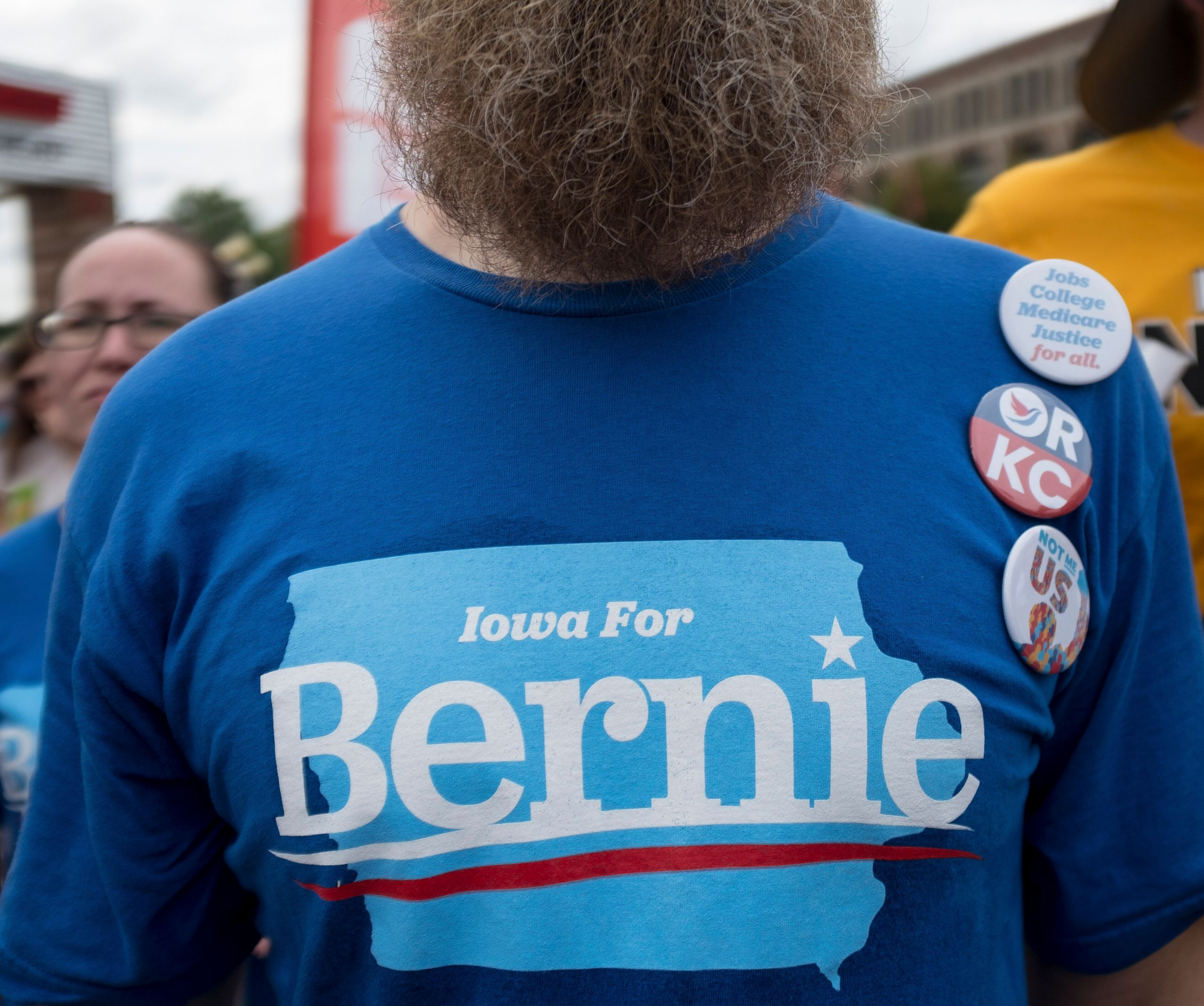 A Bernie Sanders supporter listens as the Vermont senator speaks at the Iowa State Fair on Aug. 11, 2019.