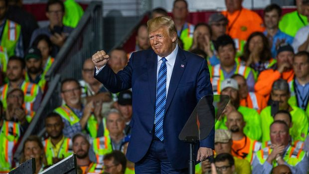 President Donald Trump leaves the stage after speaking to a crowd of construction workers before touring Royal Dutch Shell's petrochemical cracker plant on Tuesday, Aug. 13, 2019 in Monaca, Pa. (Andrew Rush/Pittsburgh Post-Gazette via AP)