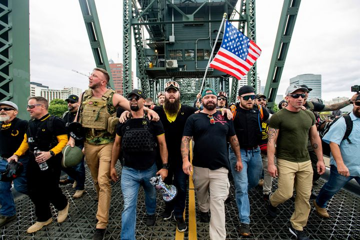 """Members of the Proud Boys and other right-wing demonstrators march across the Hawthorne Bridge during an """"End Domestic Terror"""