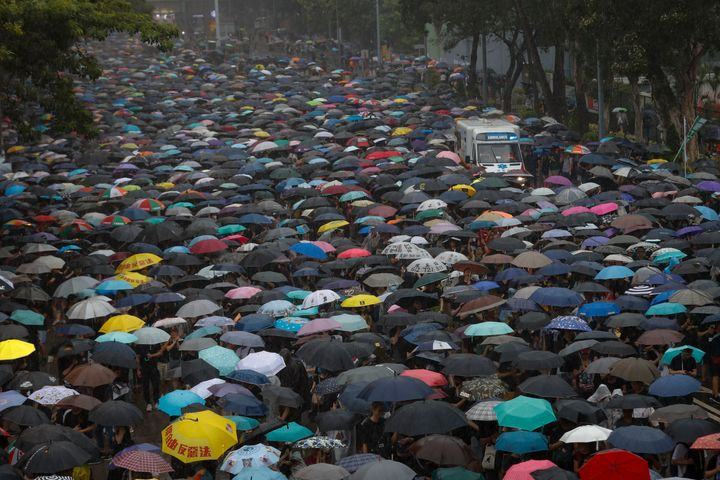 Tens Of Thousands Of Hong Kong Protesters March Through Heavy Rain