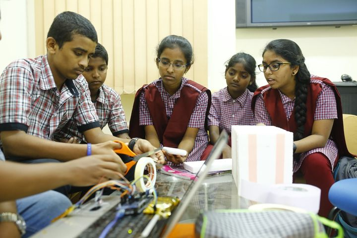 Students from a TSWREIS school working on the Swaerosat 1 payload.