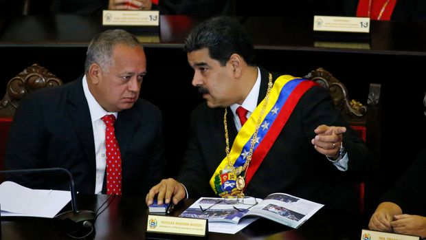 FILE - In this Jan. 24, 2019 file photo, Venezuelan President Nicolas Maduro, right, speaks with Constitutional Assembly President Diosdado Cabello at the Supreme Court during an annual ceremony that marks the start of the judicial year in Caracas, Venezuela. The U.S. has opened up secret communications with Cabello as members of Maduro's inner circle seek guarantees they won't face retribution if they cede to growing demands to remove him, a senior administration official told The Associated Press on Saturday, Aug. 17, 2019. (AP Photo/Ariana Cubillos, File)
