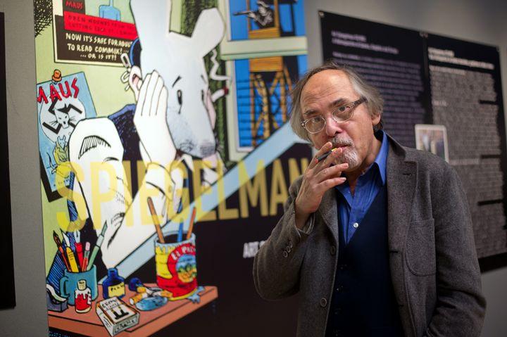 """Maus"" creator Art Spiegelman poses next to his artwork in Paris in 2012."