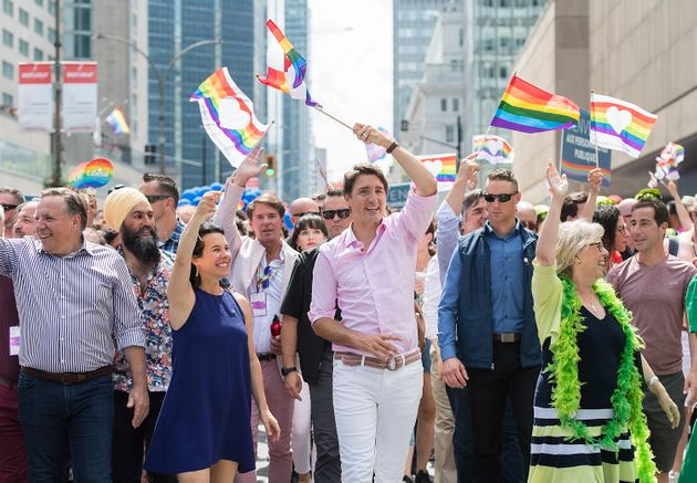 Prime Minister Justin Trudeau attends the annual Montreal Pride parade with, from left, Quebec Premier...