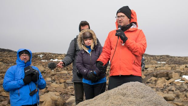 Andri Snaer Magnason (R), Icelandic writer and author of the plaque text  speaks at the unveiling of a monument at site of Okjokull, Iceland's first glacier lost to climate change in the west of Iceland on August 18, 2019. - Alos in picture are Dominic Boyer, Professor of Anthropology at Rice University in the USA (L) and Cymene Howe, Professor of Anthropology at Rice University in the USA. (Photo by Jeremie RICHARD / AFP)        (Photo credit should read JEREMIE RICHARD/AFP/Getty Images)