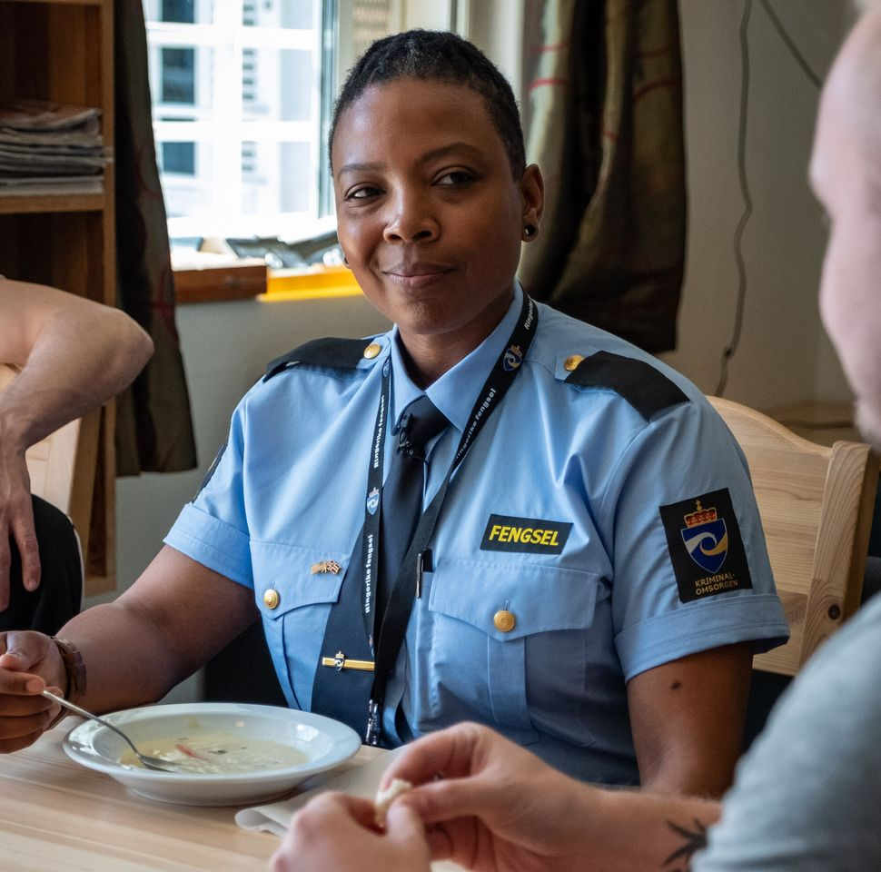 Turquoise Danford, an SCI Chester correctional officer,eating fish soup with a Ringerike inmate named Joakim.