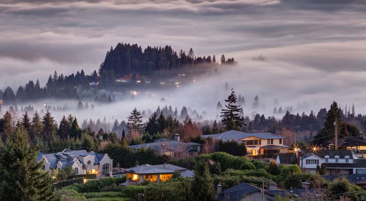 An aerial view of fog descending on homes in West Vancouver.