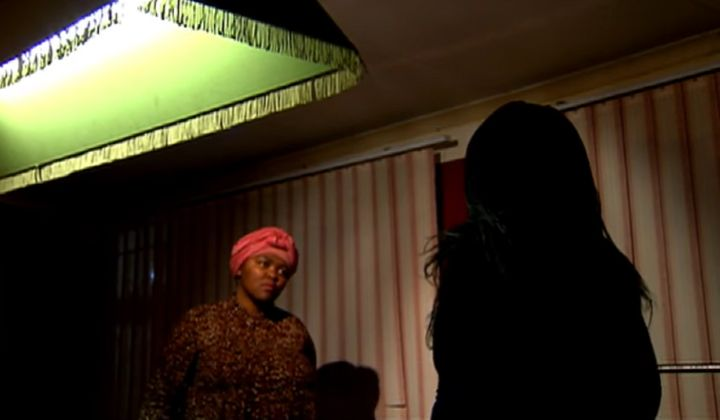 The mother, whose silhouette can be seen in this image from a SABC News interview, has chosen to remain anonymous to protect