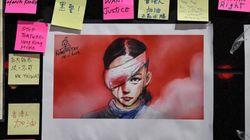 """香港デモ参加者が右目にガーゼで連帯示す。「失明した」とされる女性は""""真のムーランだ"""""""