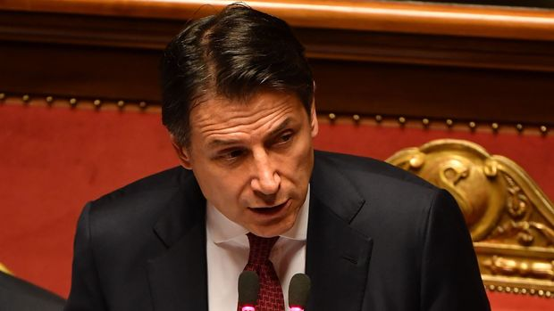 "Italian Prime Minister Giuseppe Conte delivers a speech at the Italian Senate, in Rome, on August 20, 2019, as the country faces a political crisis. - Italy's Premier Conte says to offer resignation during his speech at the Senate after calling Italy's far-right Interior Minister Matteo Salvini ""irresponsible"" to spark a political crisis by pulling the plug on the governing coalition. (Photo by Andreas SOLARO / AFP)        (Photo credit should read ANDREAS SOLARO/AFP/Getty Images)"