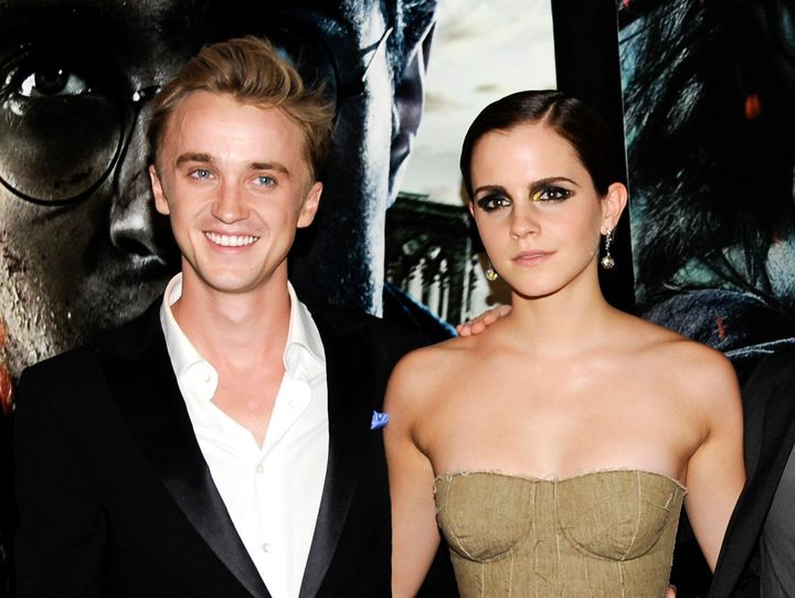 "Tom Felton and Emma Watson arrive at the premiere of the final ""Harry Potter"" movie in July 2011."