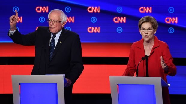 Democratic presidential hopeful US Senator from Massachusetts Elizabeth Warren (R) speaks next to US senator from Vermont Bernie Sanders during the first round of the second Democratic primary debate of the 2020 presidential campaign season hosted by CNN at the Fox Theatre in Detroit, Michigan on July 30, 2019. (Photo by Brendan Smialowski / AFP)        (Photo credit should read BRENDAN SMIALOWSKI/AFP/Getty Images)