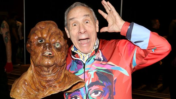 """LAS VEGAS, NEVADA - JANUARY 25: Actor, producer and director Lloyd Kaufman holds up a mask of the character The Toxic Avenger from the movie """"The Toxic Avenger"""" at the 2019 AVN Adult Entertainment Expo at the Hard Rock Hotel & Casino on January 25, 2019 in Las Vegas, Nevada. (Photo by Gabe Ginsberg/FilmMagic)"""