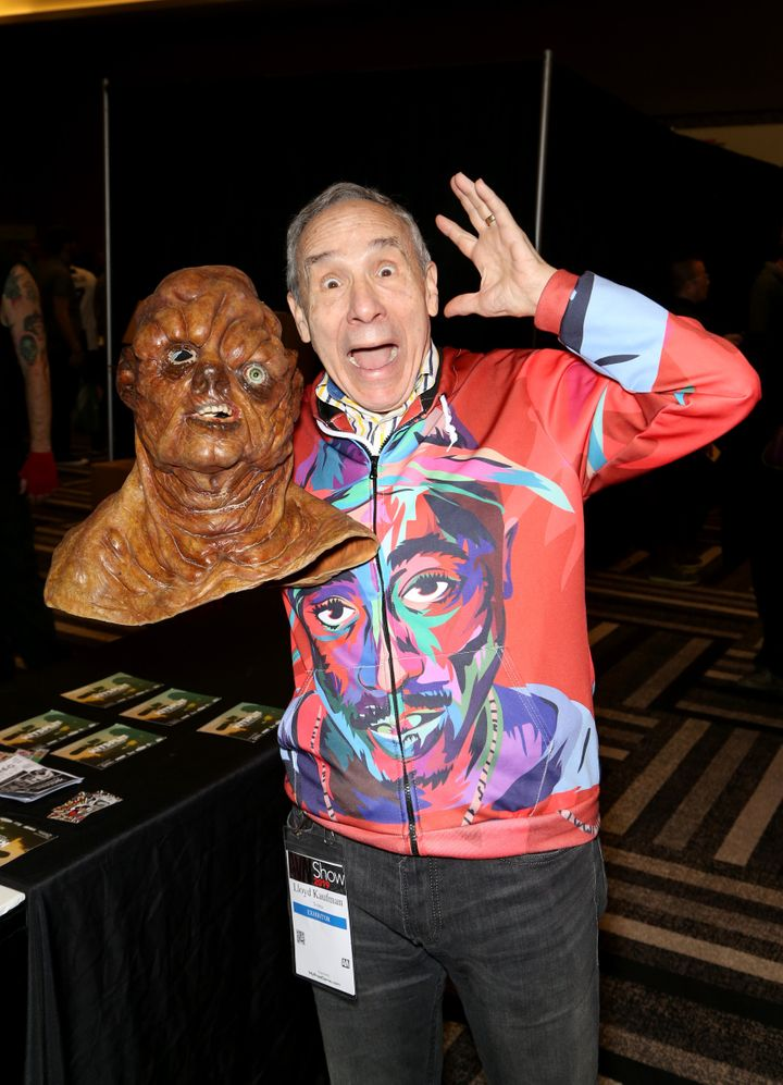 LAS VEGAS, NEVADA - JANUARY 25: Actor, producer and director Lloyd Kaufman holds up a mask of the character The Toxic Avenger