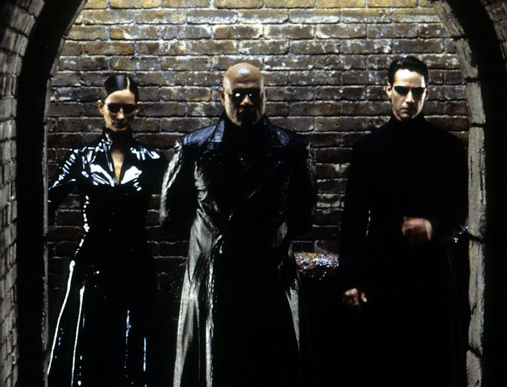 "Carrie-Ann Moss, Laurence Fishburne and Keanu Reeves in ""The Matrix."""