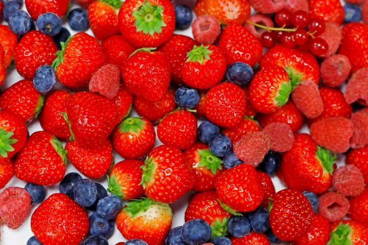 assorted fresh mix berries close up shot, berry's included strawberry, raspberries, blue berries and red currant