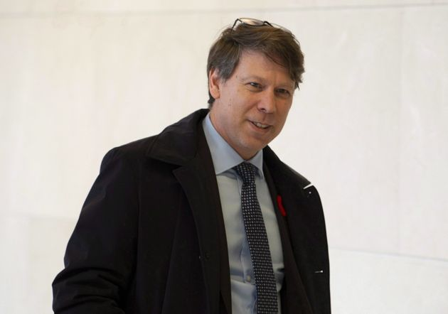 Chief Electoral Officer Stephane Perrault leaves after appearing at the House of Commons information,...