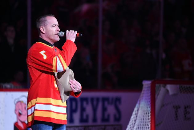 Country music singer George Canyon performs the U.S. and Canadian national anthems in Calgary before...