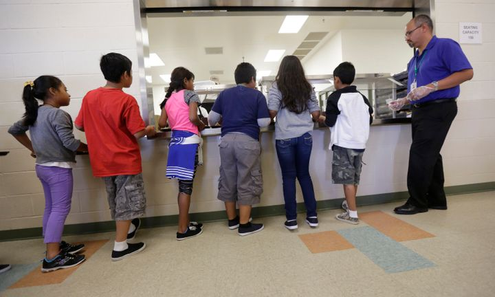 Detained immigrant children line up in the cafeteria at the Karnes County Residential Center, a detention center for immigran