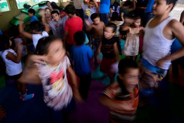 Migrant children in the hopes of reaching the United States play at a shelter in Tapachula, Chiapas state,...