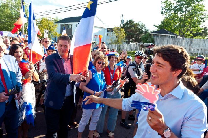Prime Minister Justin Trudeau points to Conservative LeaderAndrewScheerwhile walking with the crowd during the Tintamarre in celebration of the National Acadian Day and World Acadian Congress in Dieppe, N.B. on Aug. 15, 2019.