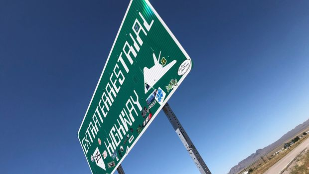 "A sign reading ""Extraterrestrial Highway"" stands along the road in Rachel, Nevada, U.S., August 16,2019.  Photo taken August 16, 2019.  REUTERS/Rollo Ross"